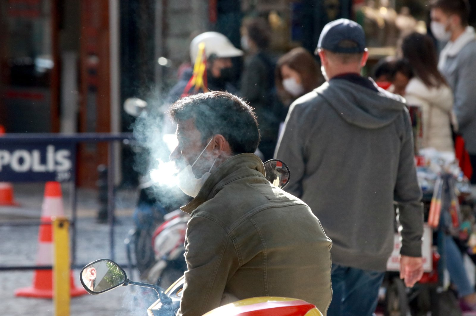A man who lowered his mask smokes in Kırklareli, northwestern Turkey, Nov. 13, 2020. (AA Photo)