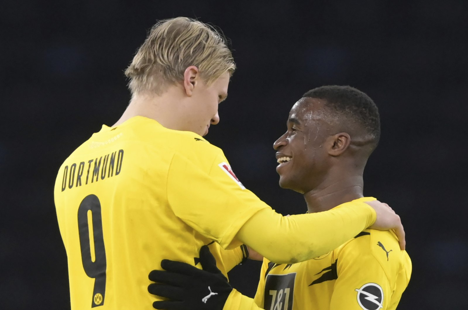 Dortmund's Erling Haaland (L) and Youssoufa Moukoko (R) hug each other after the match, in Berlin, Germany, Nov. 21, 2020. (AP Photo)