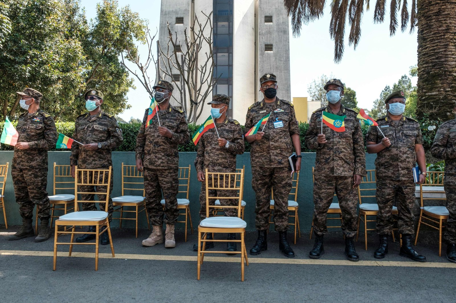 Members of the Ethiopian Army stand holding Ethiopian national flags during an event to honor the national defense forces, Addis Ababa, Nov. 17, 2020. (AFP Photo)