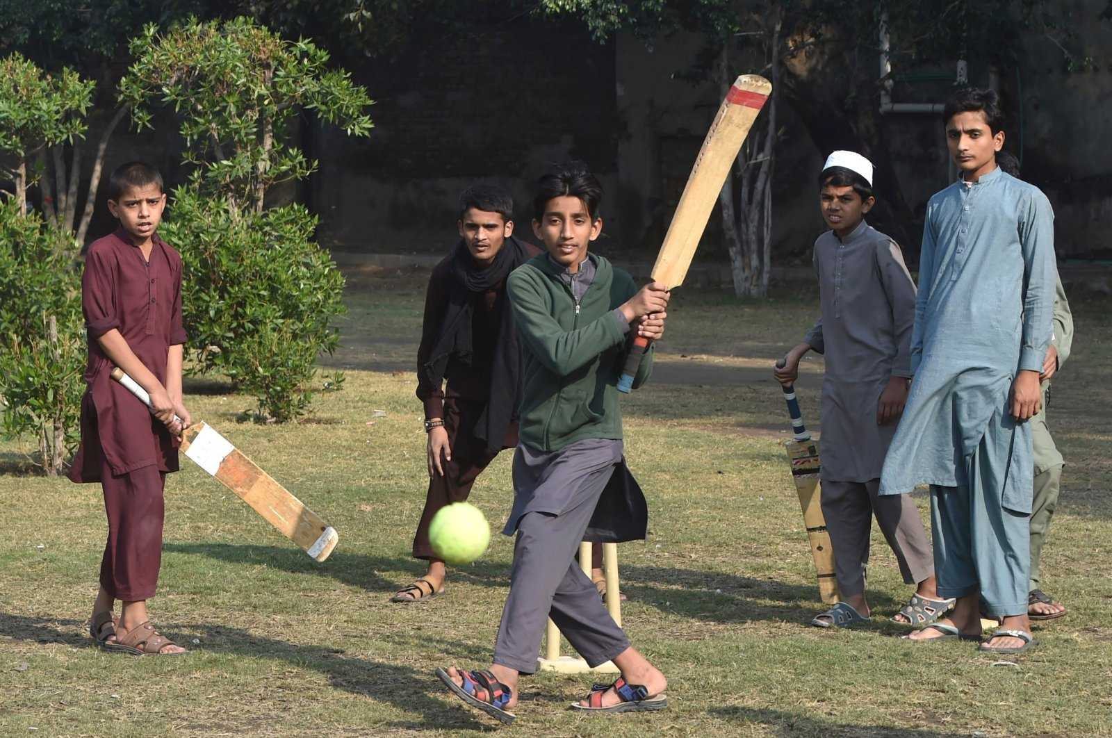Pakistani youth play cricket at a playground in Lahore, Pakistan, Nov. 19, 2020. (AFP Photo)