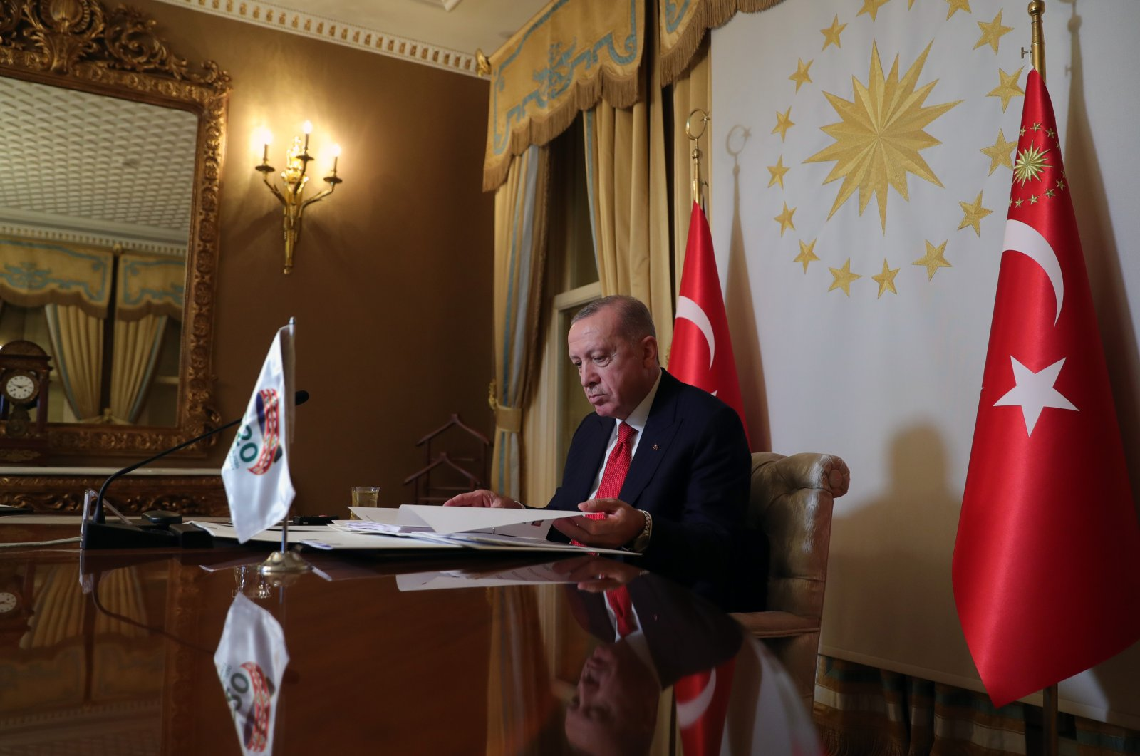 President Recep Tayyip Erdoğan prepares to attend the G-20 Leaders Summit, held online this year due to the coronavirus pandemic, in the Vahdettin Mansion, Istanbul, Turkey, Nov. 21, 2020. (AA Photo)