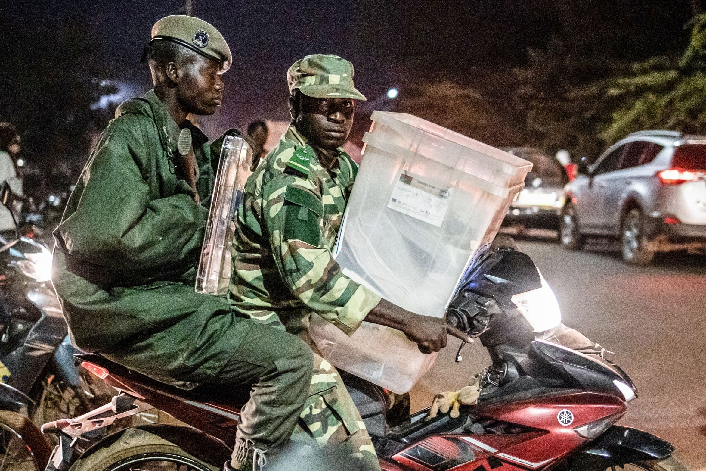 Security forces leave a city hall where the Independent National Electoral Commission (CENI) distributes electoral material to polling station directors and members with a polling box on the eve of the presidential election in the capital Ouagadougou, Burkina Faso, Nov. 21, 2020. (Photo by OLYMPIA DE MAISMONT / AFP)