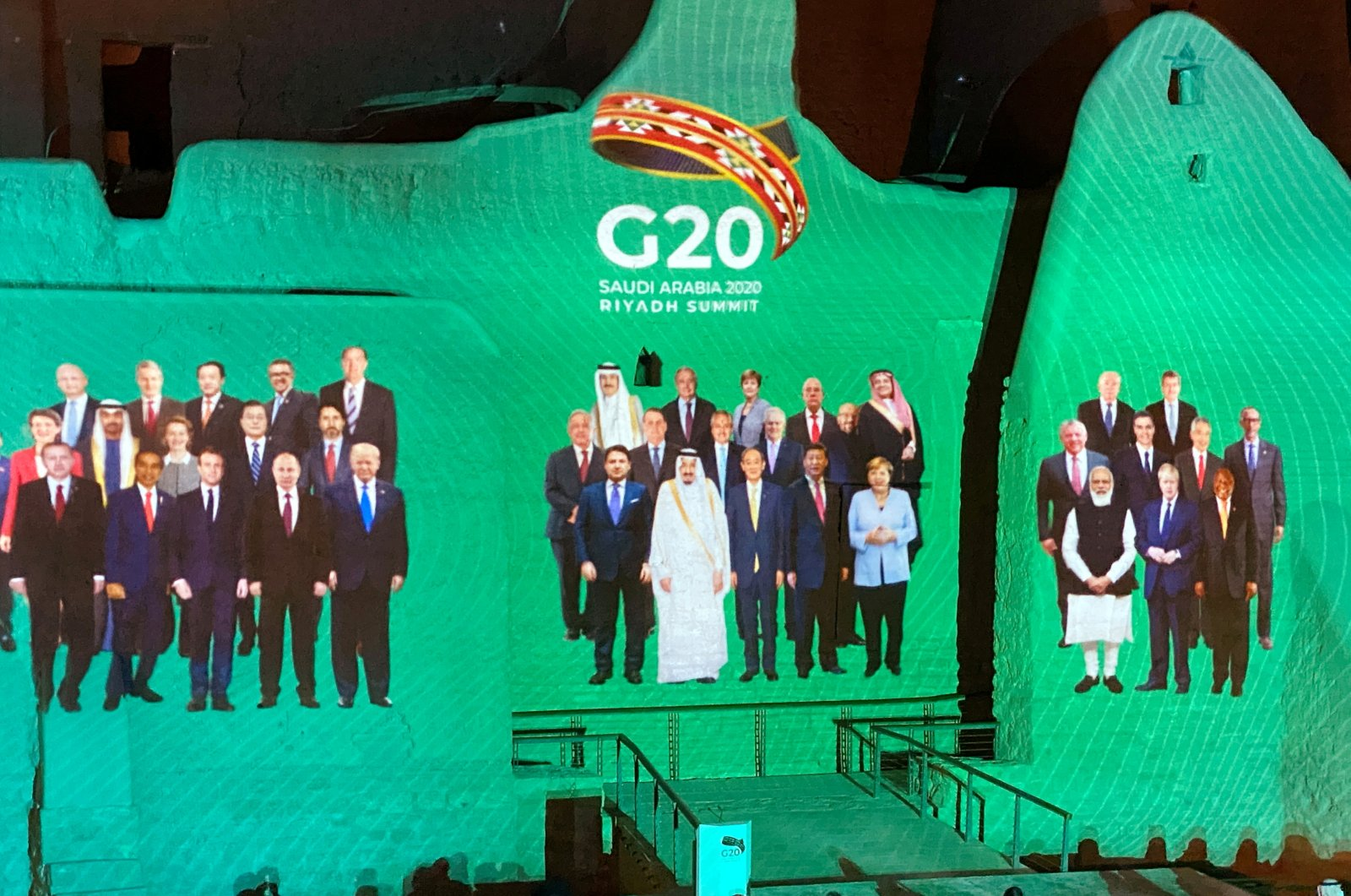 """The """"Family Photo"""" for the annual G-20 world leader's summit is projected onto Salwa Palace in At-Turaif, one of Saudi Arabia's UNESCO World Heritage sites, in Diriyah, Saudi Arabia, Nov. 20, 2020. (REUTERS Photo)"""