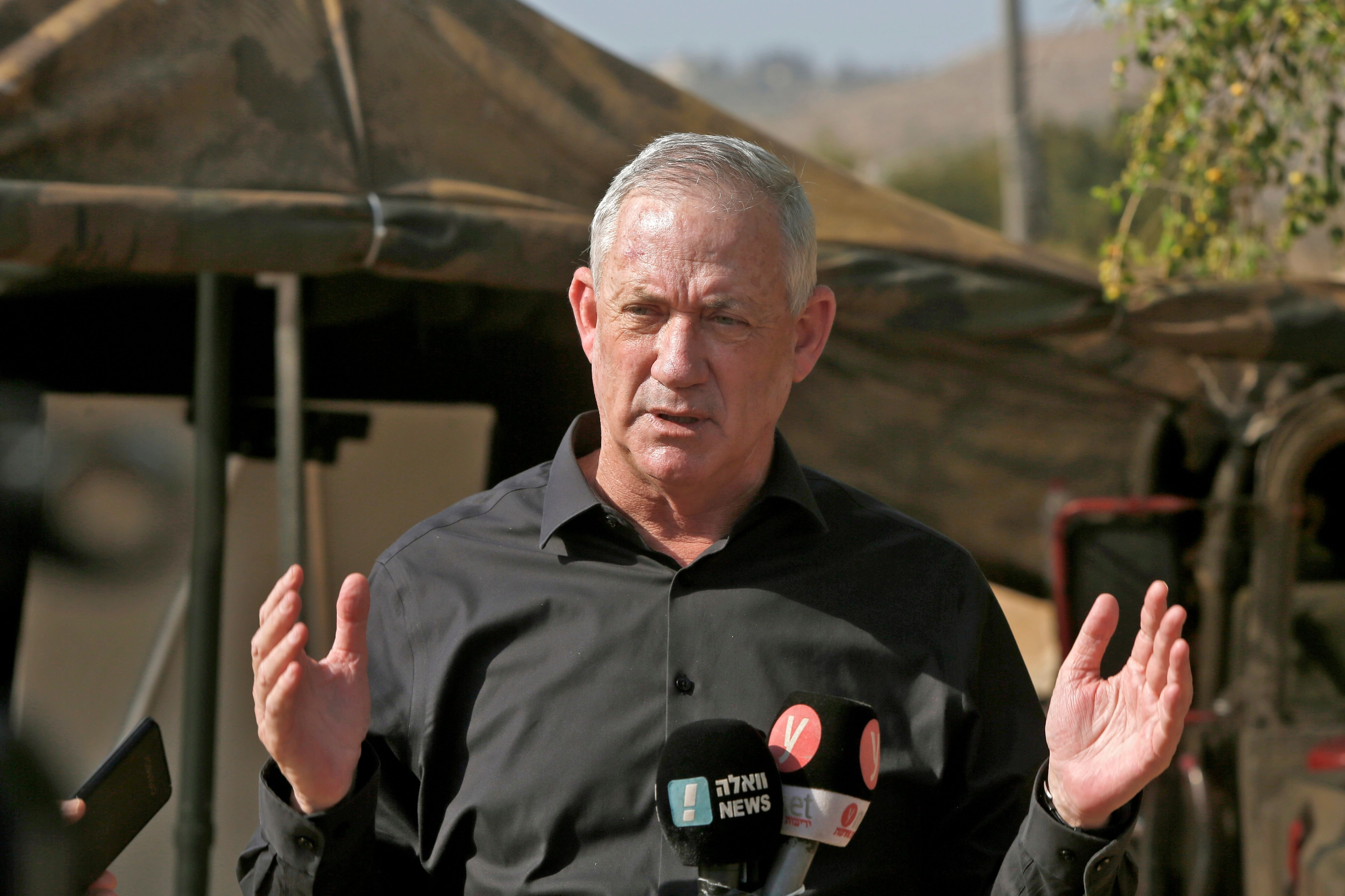 """Benny Gantz, Israel's Alternate Prime Minister and Defence Minister, speaks to the media during the """"Deadly Arrow"""" military drill near Kibbutz Ravid, northern Israel, Oct. 27, 2020. (Photo by JALAA MAREY / AFP)"""