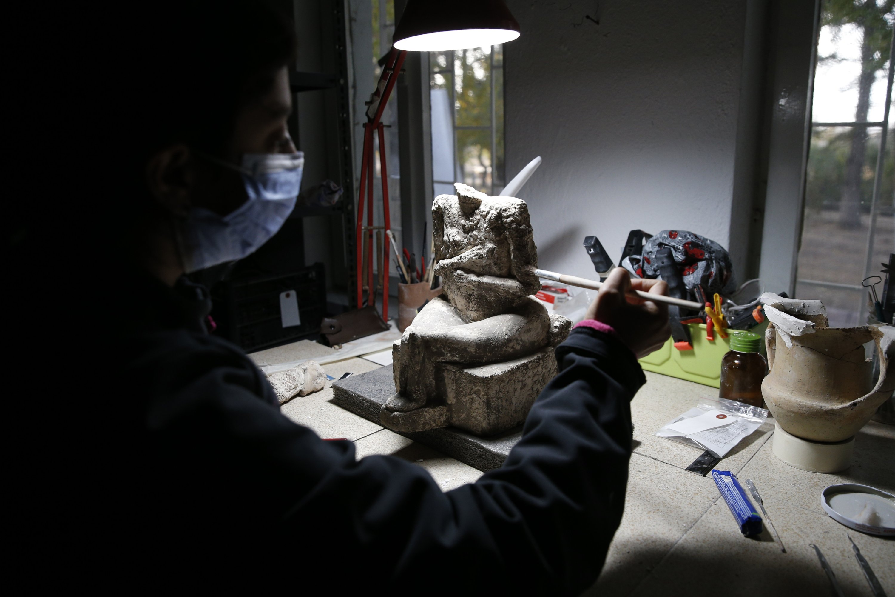 An archaeologist works on the goddess statue found at the Kültepe archaeological site, Kayseri, central Turkey, Nov. 22, 2020. (AA PHOTO)