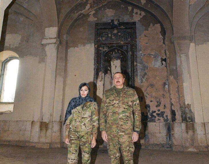 Azerbaijani President Ilham Aliyev (R) and his wife Mihriban Aliyeva visit a mosque in Aghdam on Nov. 23, 2020 (AA Photo)