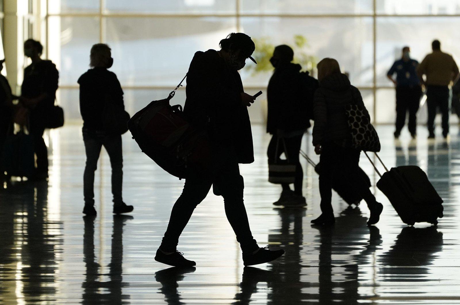 Passengers walk through Salt Lake City International Airport in Salt Lake City, Oct. 27, 2020. (AP Photo)