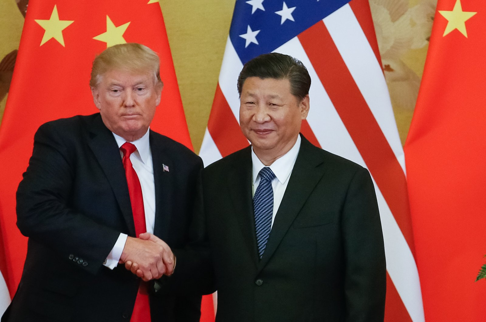 U.S. President Donald Trump and Chinese President Xi Jinping shake hands during a press conference at the Great Hall of the People (GHOP) in Beijing, China, Nov. 9, 2017. (EPA Photo)