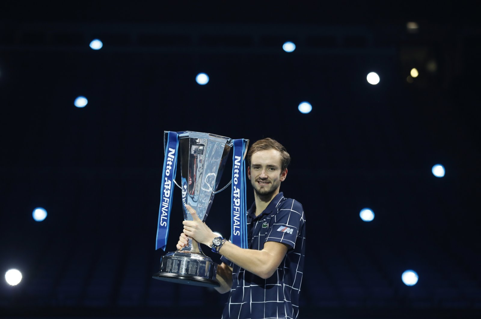 Daniil Medvedev holds up his trophy after winning the ATP Finals tennis tournament in London, Britain, Nov. 22, 2020. (AP Photo)