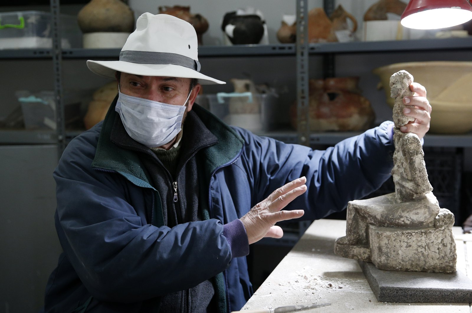 Professor Fikri Kulakoğlu holds the goddess statue found at the Kültepe archaeological site, Kayseri, central Turkey, Nov. 22, 2020. (AA PHOTO)