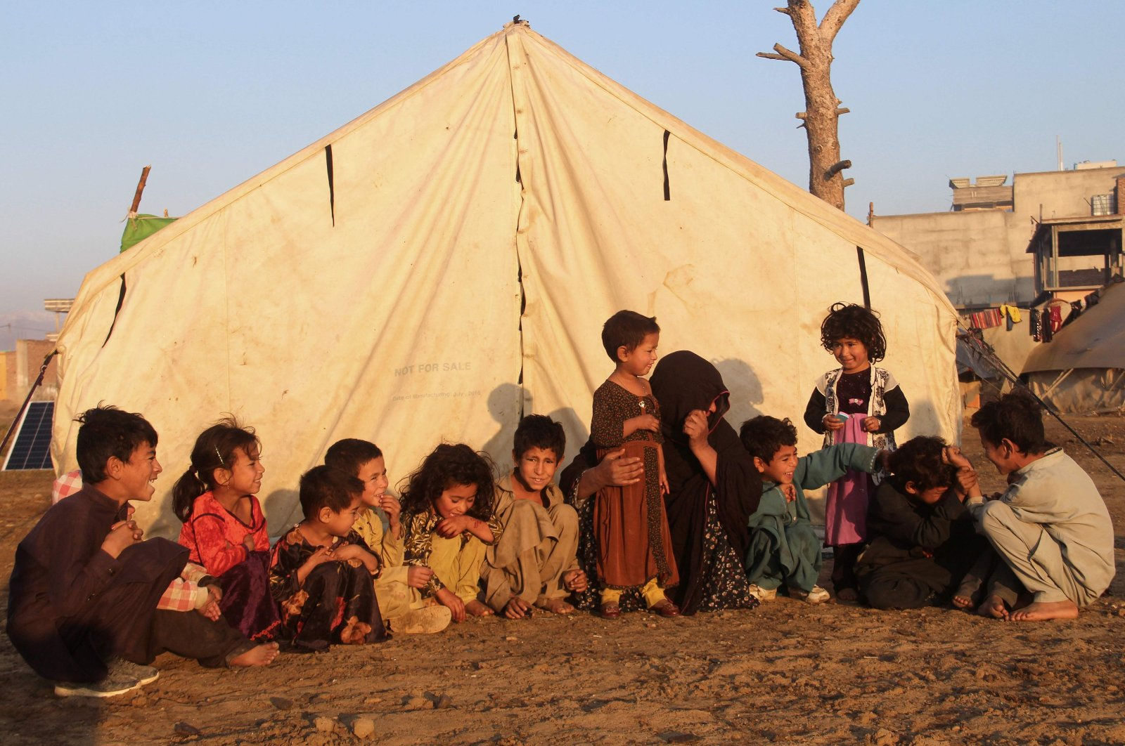 Internally displaced children sit outside a tent at a refugee camp in Khost province, eastern Afghanistan, Nov. 17, 2020. (AFP Photo)