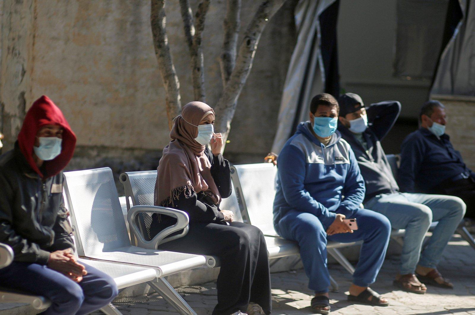 Palestinians wearing protective face masks sit at Shifa hospital, Gaza City, Nov. 22, 2020. (REUTERS Photo)