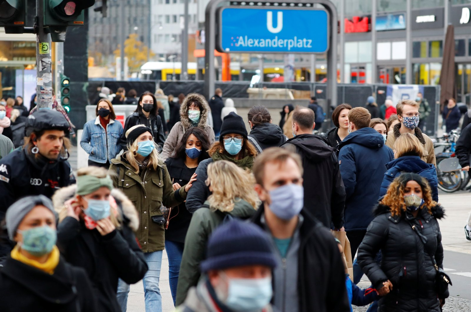 People wear protective masks as they walk in the Alexanderplatz shopping area amid the coronavirus outbreak in Berlin, Germany, Nov. 21, 2020. (Reuters Photo)