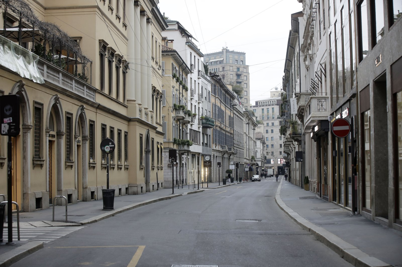 A view of a deserted street in downtown Milan amid the coronavirus locdown, Milan, Italy, March 12, 2020. (AP Photo)