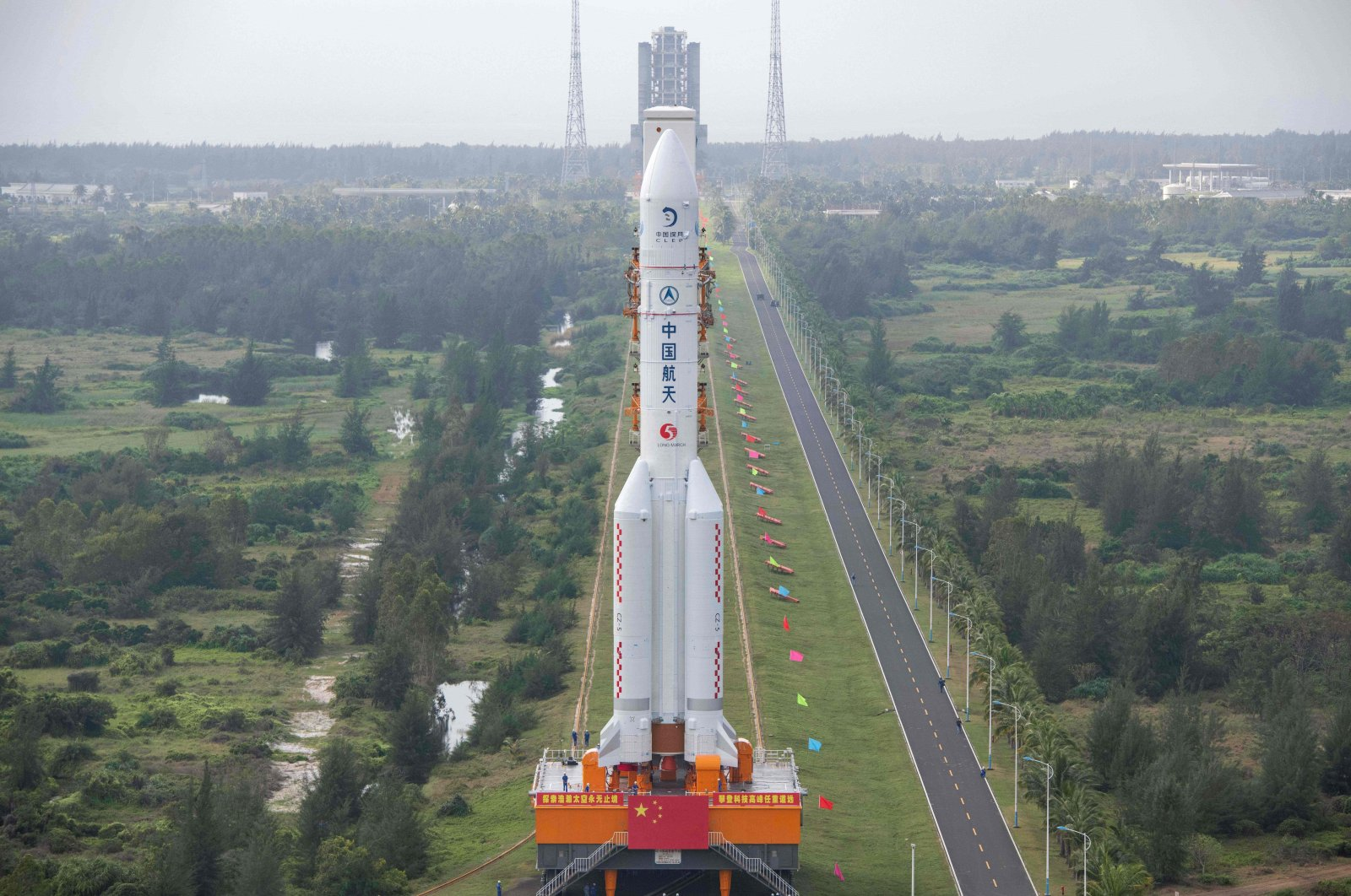 The Long March-5 rocket, which has launched China's Chang'e-5 lunar probe, seen being vertically transported to the launching area at the Wenchang Spacecraft Launch Site in southern China's Hainan province, Nov. 17, 2020. (AFP Photo)