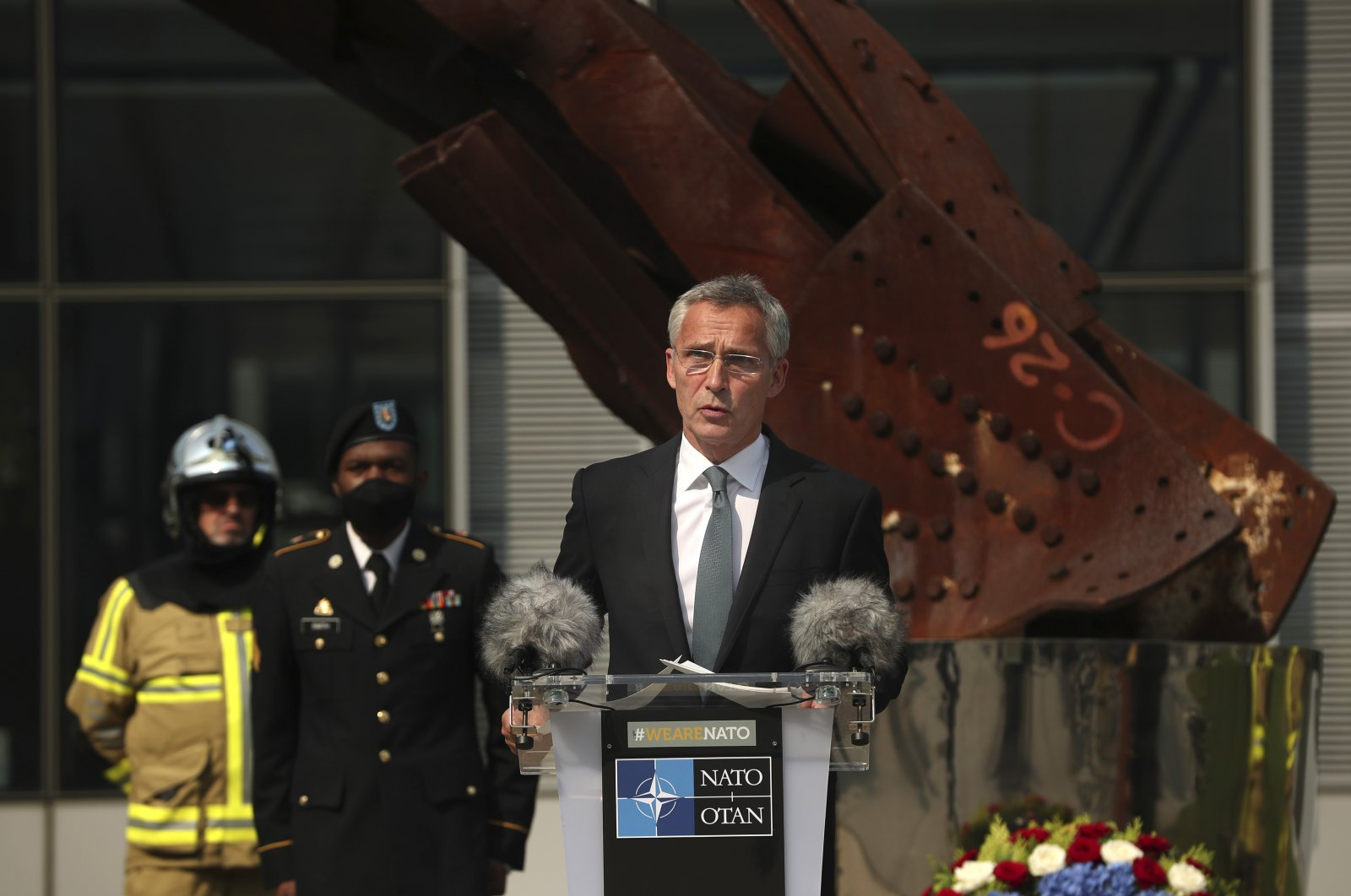 NATO Secretary-General Jens Stoltenberg speaks during a ceremony marking the 19th anniversary of the Sept. 11, 2001 attacks in New York City, at NATO headquarters in Brussels, Sept. 11, 2020. (AP Photo)