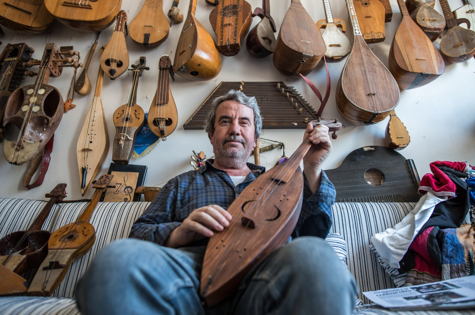 Feridun Obul poses with string instruments he made at his workshop in Sultanahmet Square, Istanbul, Turkey, June 23, 2018. (PHOTO BY MURAT ŞENGÜL)