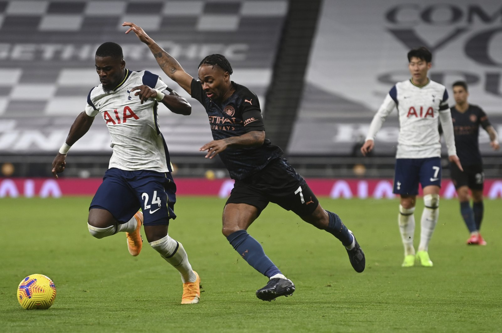 Tottenham's Serge Aurier (L) is challenged by Manchester City's Raheem Sterling (R) during a match in London, England, Nov. 21, 2020. (AP Photo)