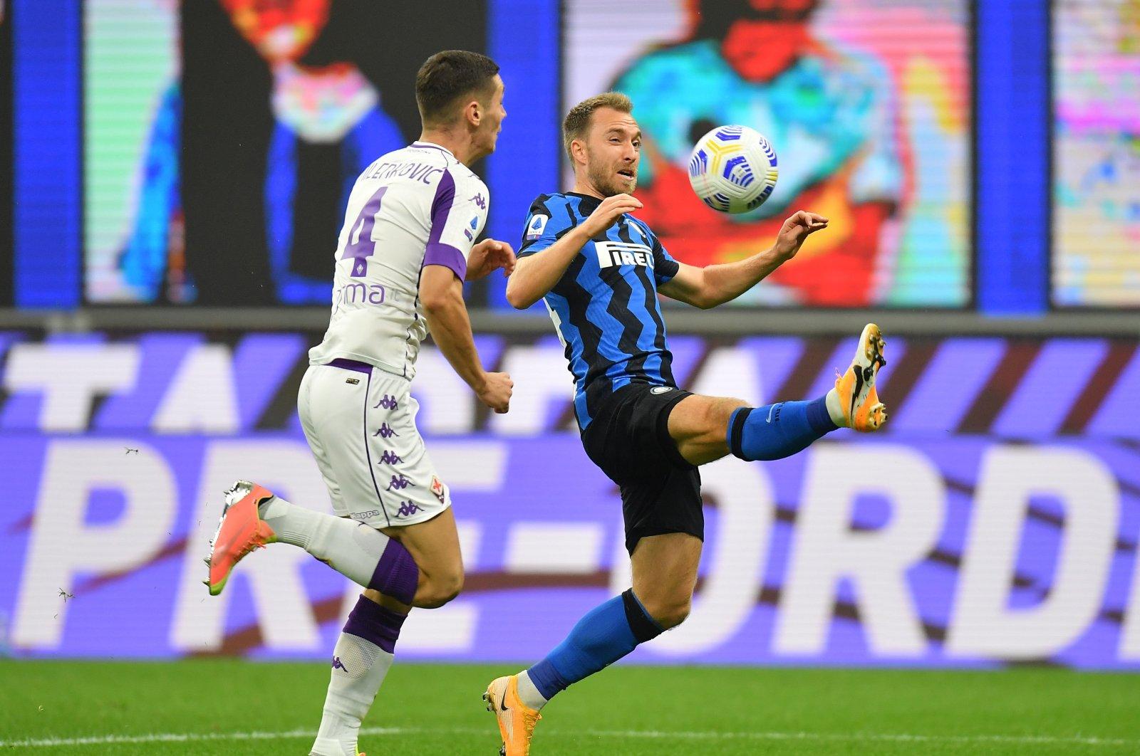 Inter Milan's Christian Eriksen (R) in action with Fiorentina's Nikola Milenkovic, in Milan, Italy, Sept. 26, 2020. (REUTERS Photo)