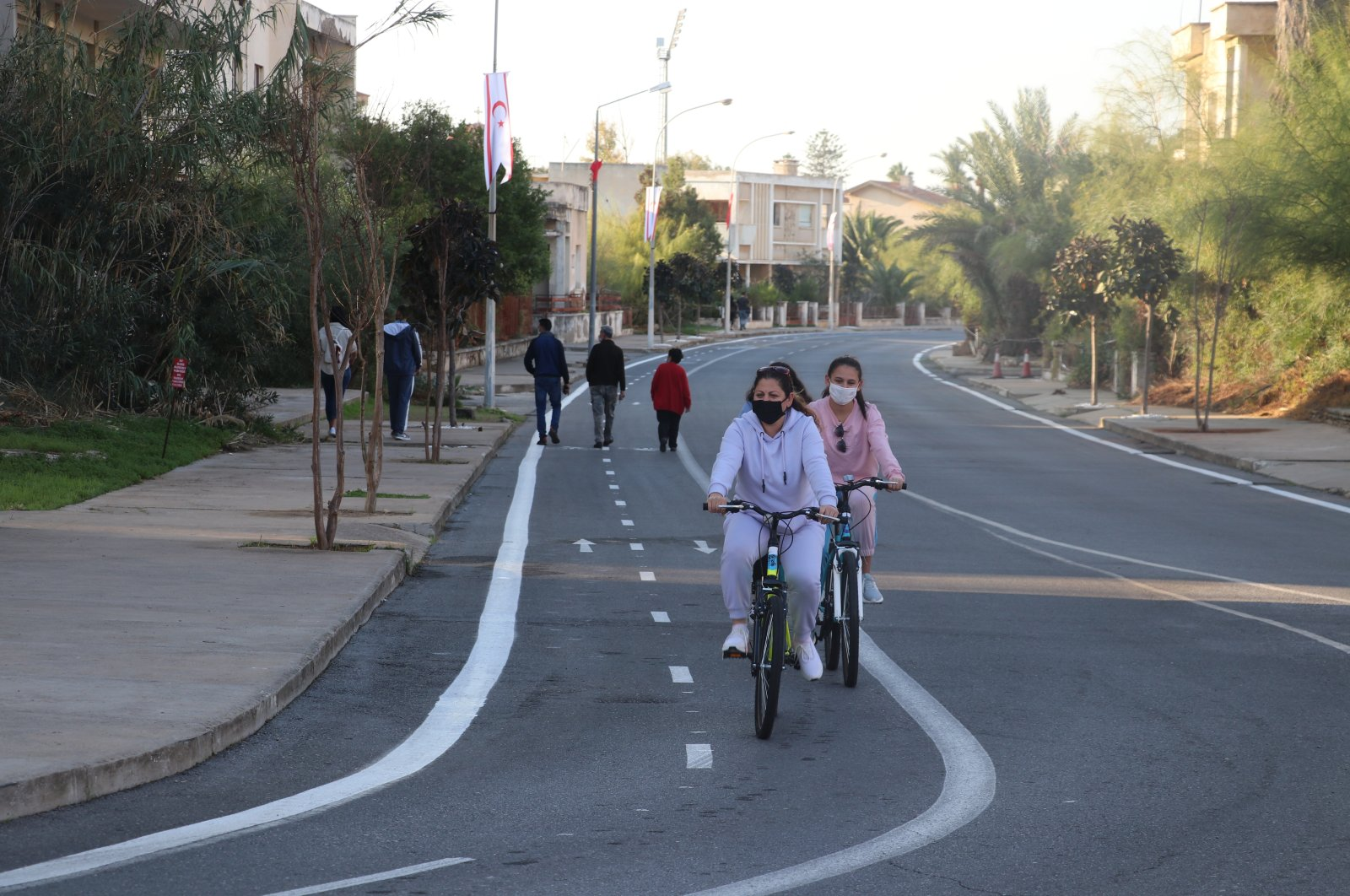 People ride bikes in the Turkish Republic of Northern Cyprus' (TRNC) Varosha city after a partial reopening of the city after 46 years, Nov. 24, 2020. (AA Photo)
