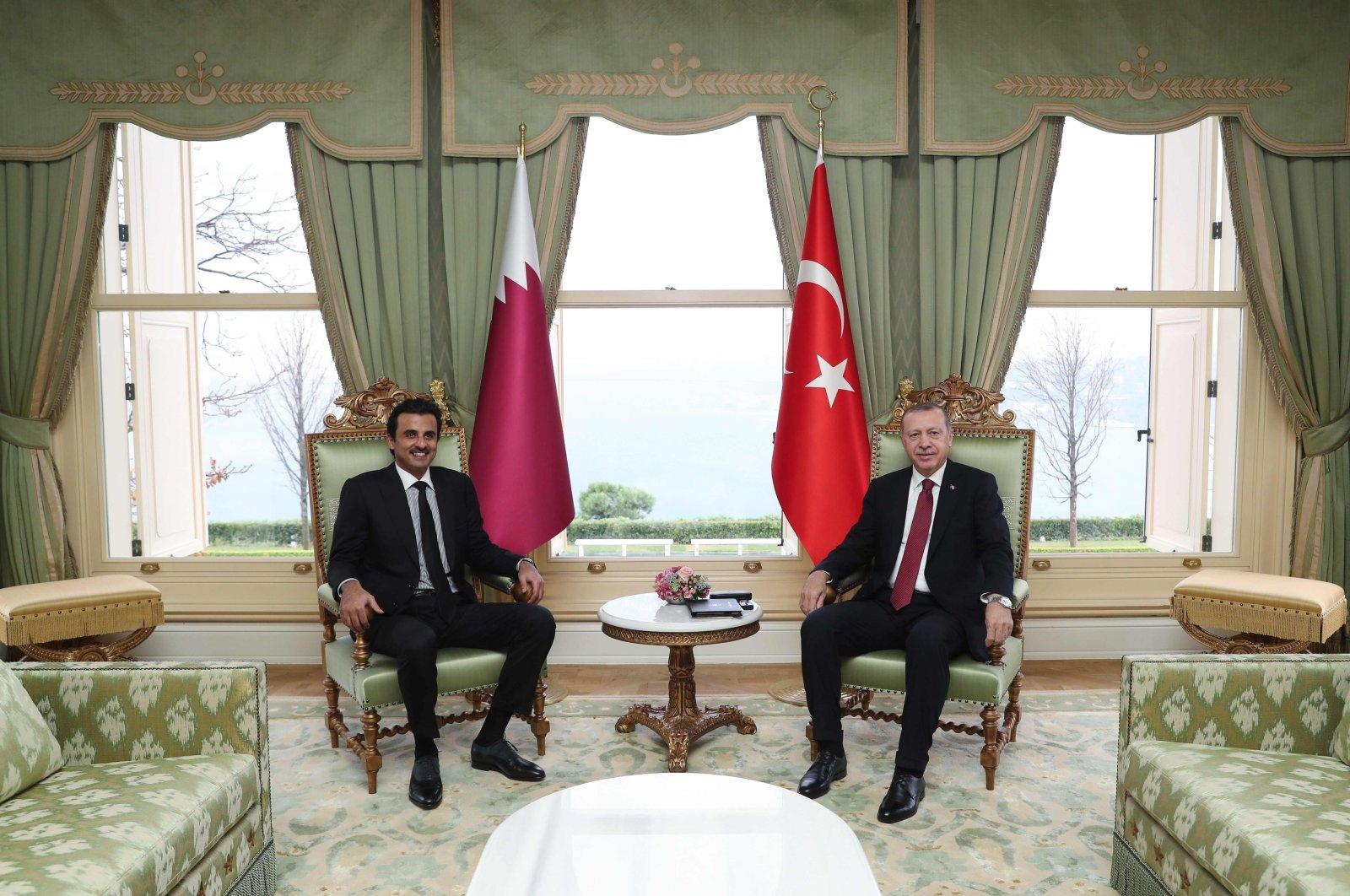 President Recep Tayyip Erdoğan (R) with Qatari Emir Sheikh Tamim bin Hamad Al Thani during the fourth meeting of Turkey-Qatar Supreme Strategic Committee, Istanbul, Nov. 26, 2018. (Photo by Turkish Presidential Press Office via AFP)
