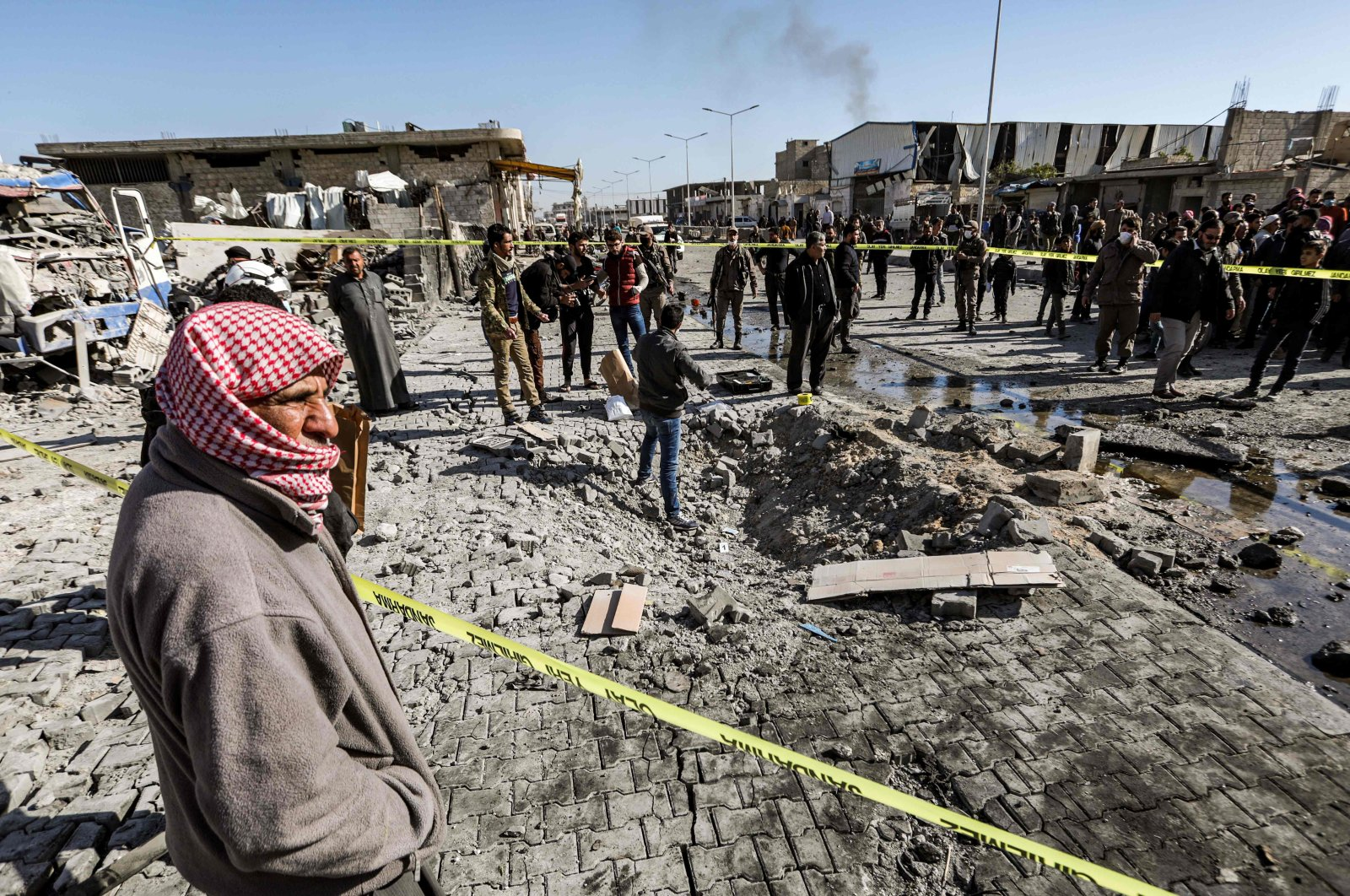 People inspect the scene of a car bomb in the northern Syrian town of al-Bab in Aleppo province, Nov. 24, 2020. (AFP Photo)