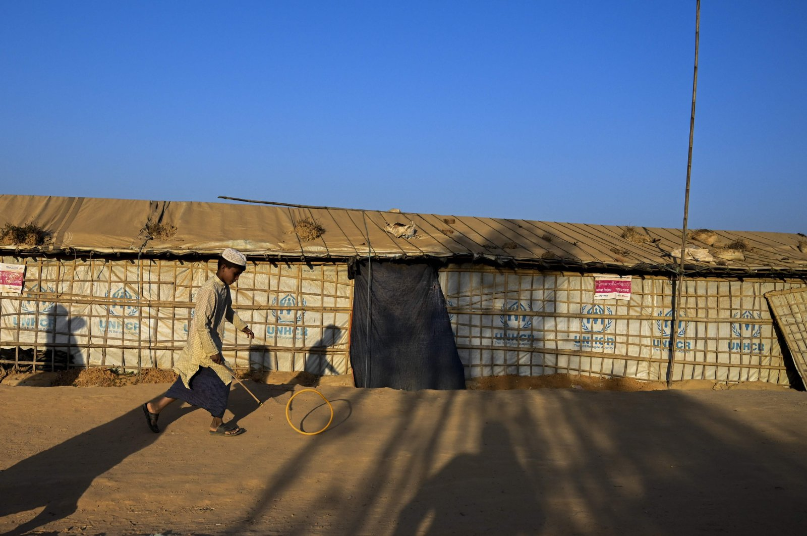 A young Rohingya refugee plays at Balukhali refugee camp in Ukhia, Bangladesh, Feb. 4, 2019. (AFP Photo)