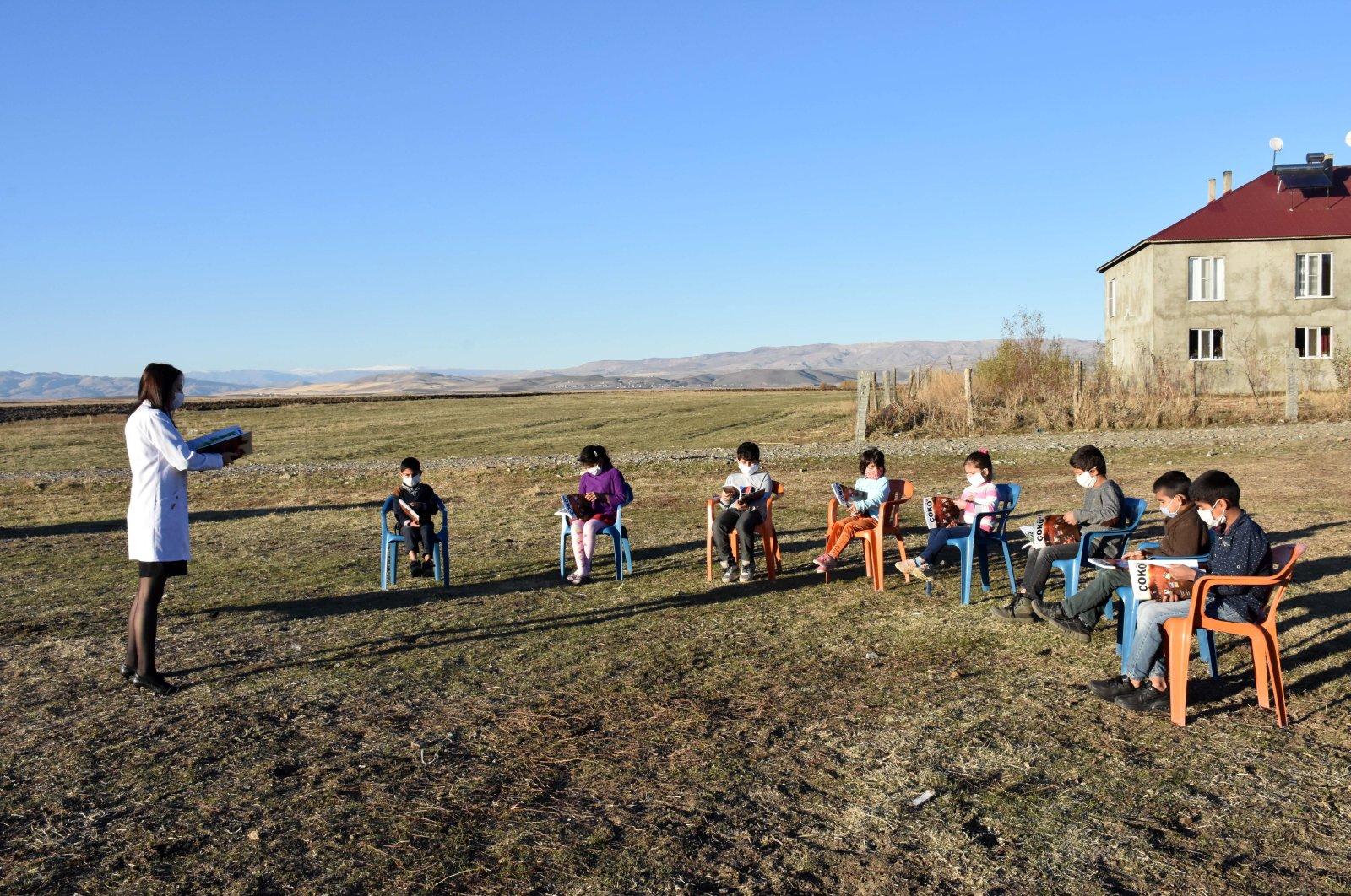 Teacher Tuğba Harmankaya reads books with her students on Teachers' Day, in Muş, eastern Turkey, Nov. 24, 2020. (AA Photo)