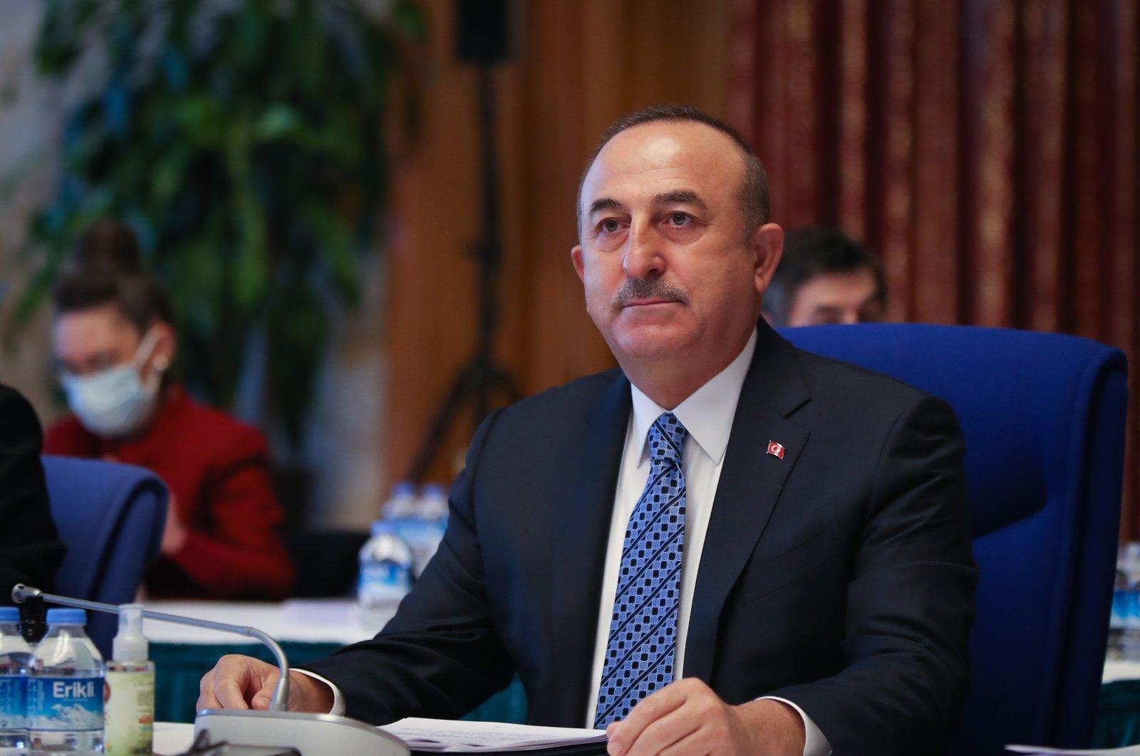 Foreign Minister Çavuşoğlu listens during a parliamentary budgetary commission meeting in Ankara, Nov. 24, 2020. (AA Photo)