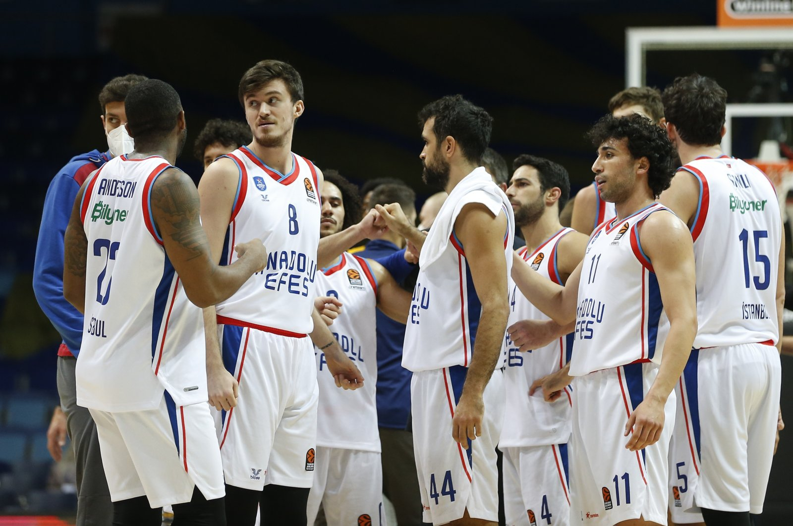 Anadolu Efes players celebrate winning the Turkish Airlines EuroLeague match against Khimki Moscow, in Moscow, Russia, Nov. 19, 2020. (AA Photo)