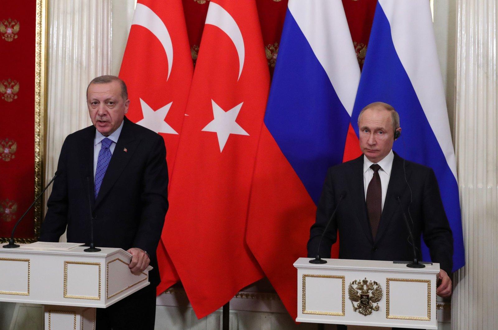 President Recep Tayyip Erdoğan (L) and his Russian counterpart Vladimir Putin attend a news conference following their talks in Moscow, Russia March 5, 2020. (Sputnik / Mikhail Klimentyev / Kremlin via Reuters)