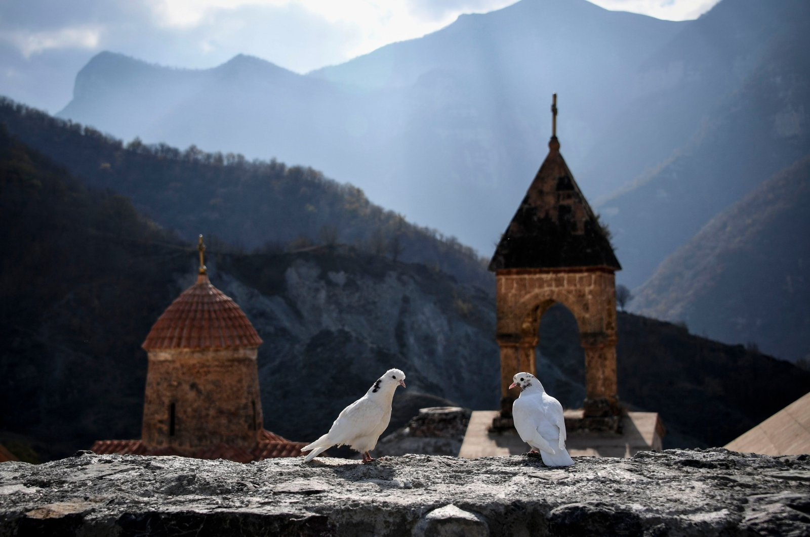 Two white doves stand on a wall of the 12th-13th century Orthodox Dadivank monastery, outside the town of Kalbajar, Azerbaijan, Nov. 12, 2020. (AFP Photo)