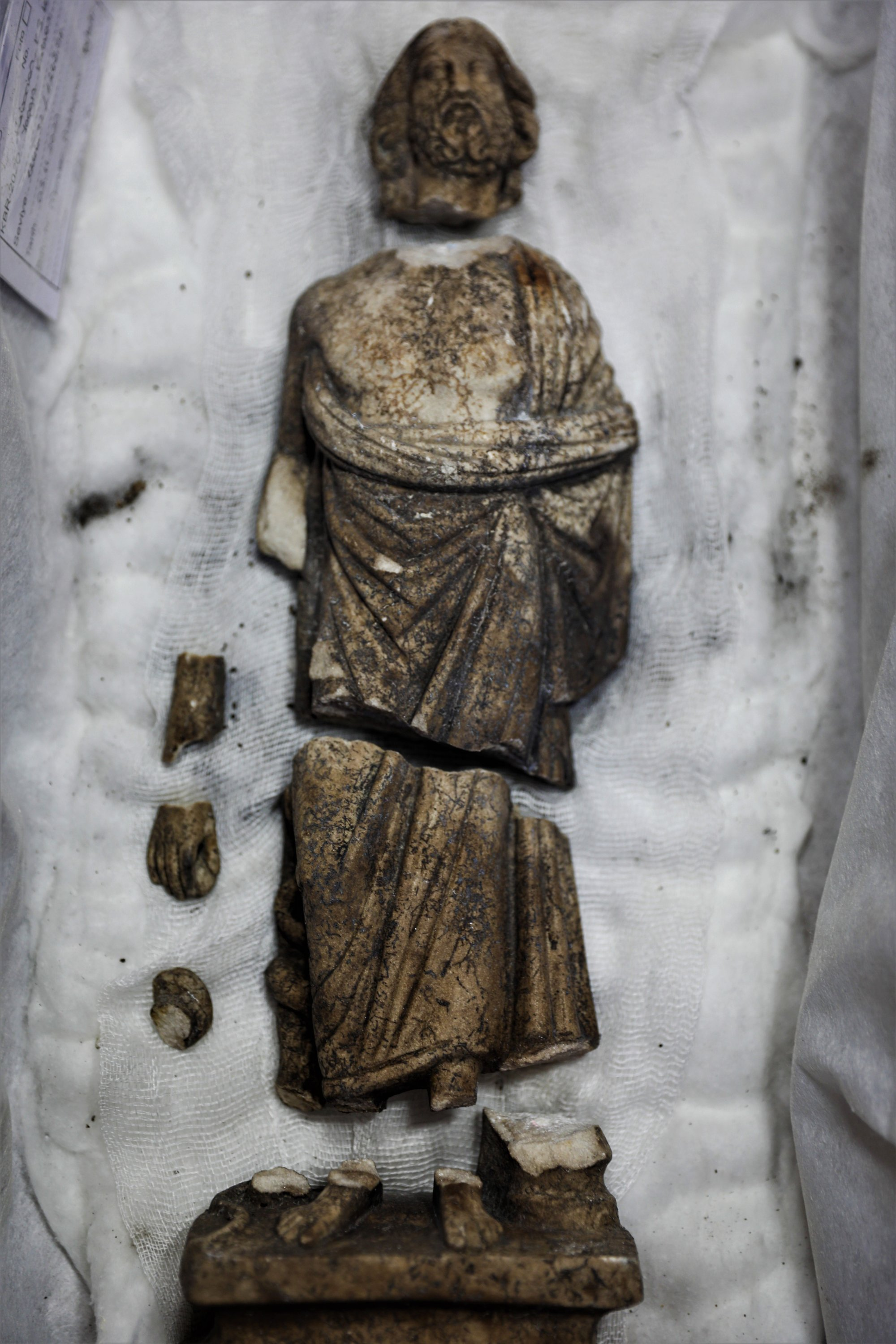 The statue of Asclepios is seen in seven pieces, found in the ancient city of Kibyra in Burdur province, southwestern Turkey, Nov. 23, 2020. (AA Photo)
