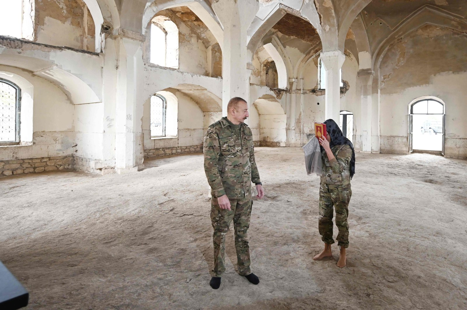 This handout picture by Azerbaijan's Presidency Press Office shows Azerbaijani President Ilham Aliyev and his wife and Azerbaijan's Vice President Mehriban Aliyeva standing inside the Aghdam Mosque in Aghdam, on Nov. 23, 2020. (AFP Photo)