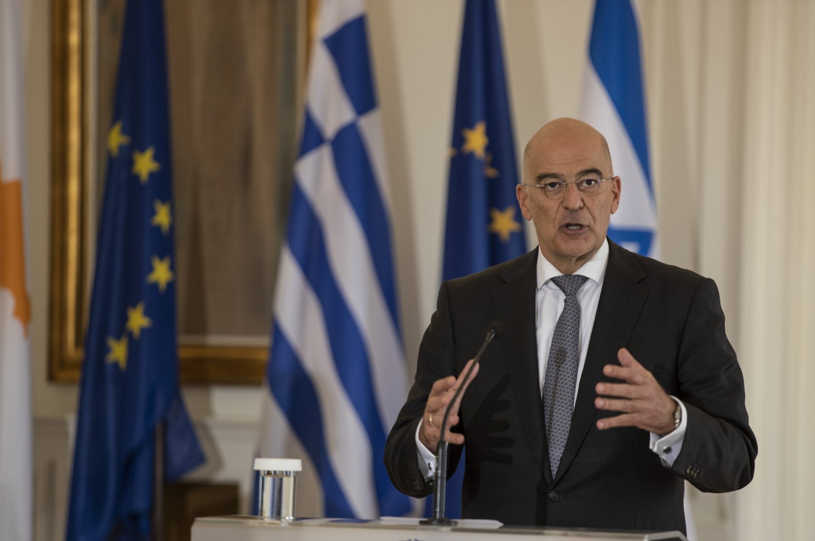 Greek Foreign Minister Nikos Dendias speaks during a joint news conference following a foreign ministers' meeting with his counterparts Gabi Ashkenazi of Israel and Nikos Christodoulides of the Greek Cypriot administration, in Athens, Greece, Oct. 27, 2020. (AP Photo)