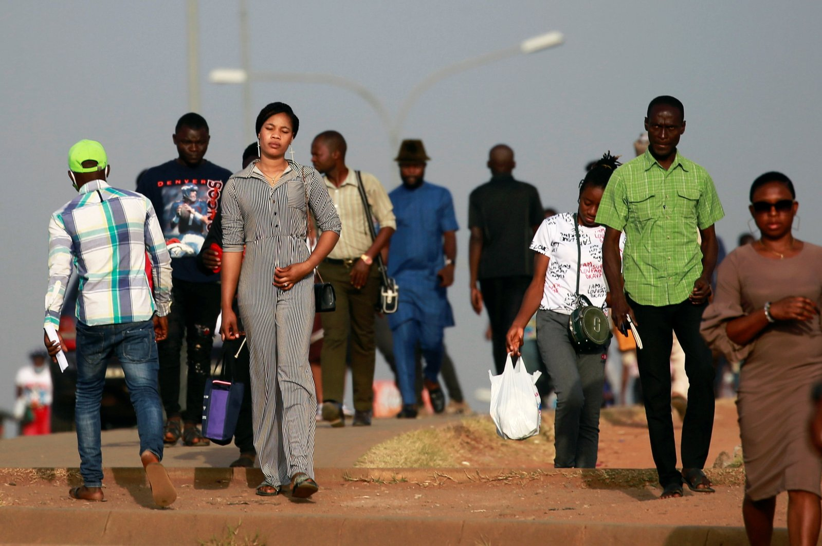 People walk as they head to work at Banex area in Abuja, Nigeria, Nov. 23, 2020. (Reuters Photo)