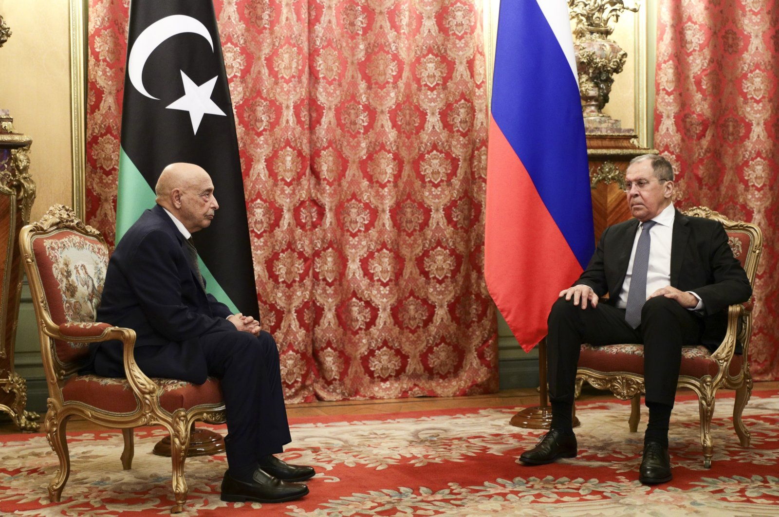 Russian Foreign Minister Sergey Lavrov (R) sits with Libya's eastern-based parliament speaker Aguila Saleh during their talks in Moscow, Russia, Nov. 24, 2020. (Russian Foreign Ministry Press Service via AP)