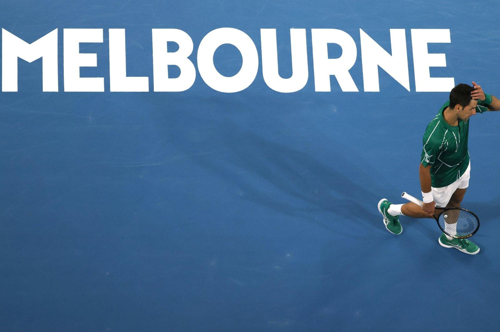 Novak Djokovic walks during the Australian Open final match against Dominic Thiem, in Melbourne, Australia, Feb. 2, 2020. (AP Photo)