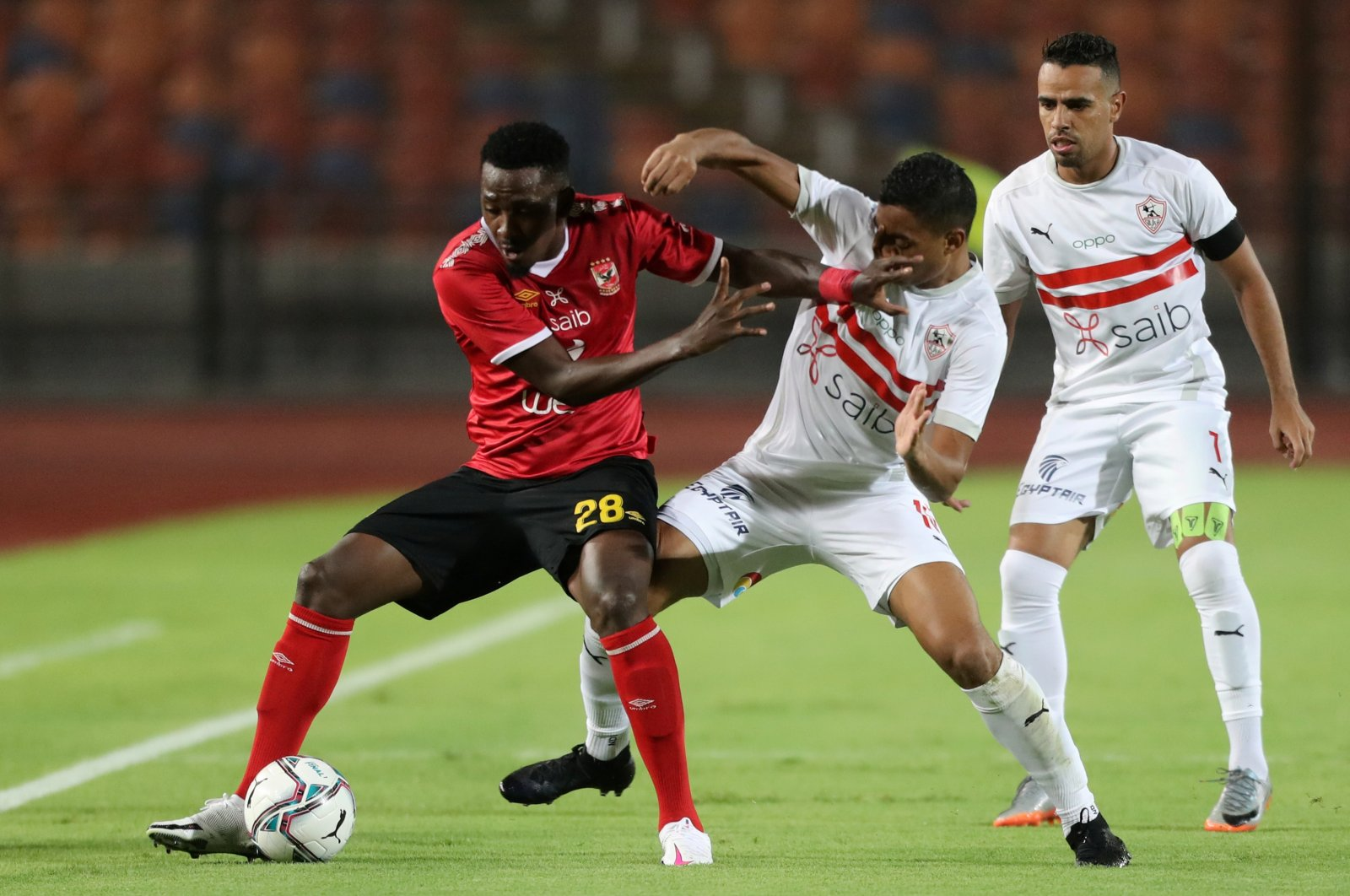 Al Ahly's Junior Ajayi (L) in action with Zamalek's Mostafa Mohamed Ahmed Abdalla during an Egyptian Premier League match in Cairo, Egypt, Aug. 22, 2020. (Reuters Photo)
