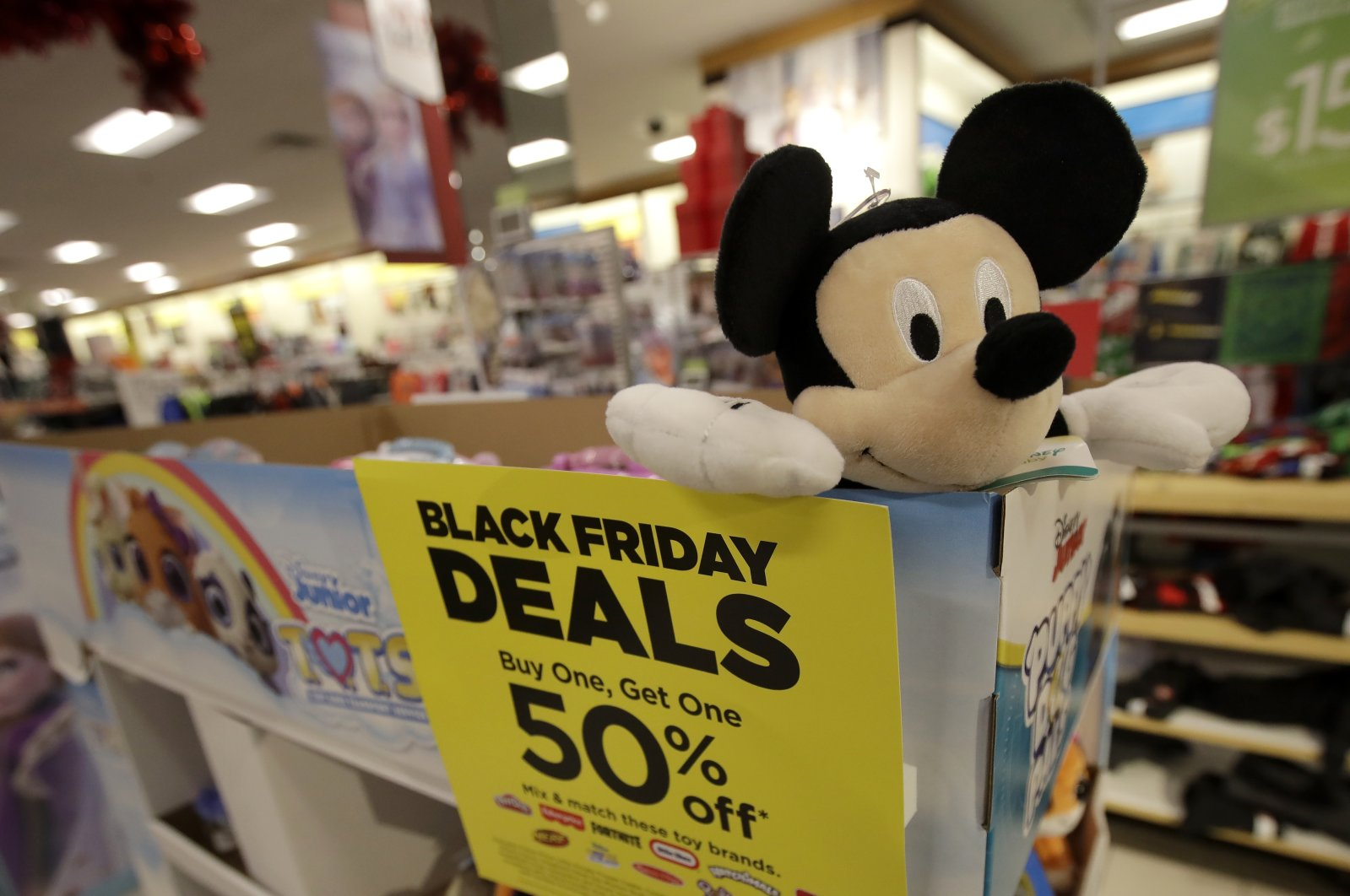 A sale sign is shown next to a Mickey Mouse doll at a Kohl's store in Colma, Calif., Friday, Nov. 29, 2019. (AP Photo)
