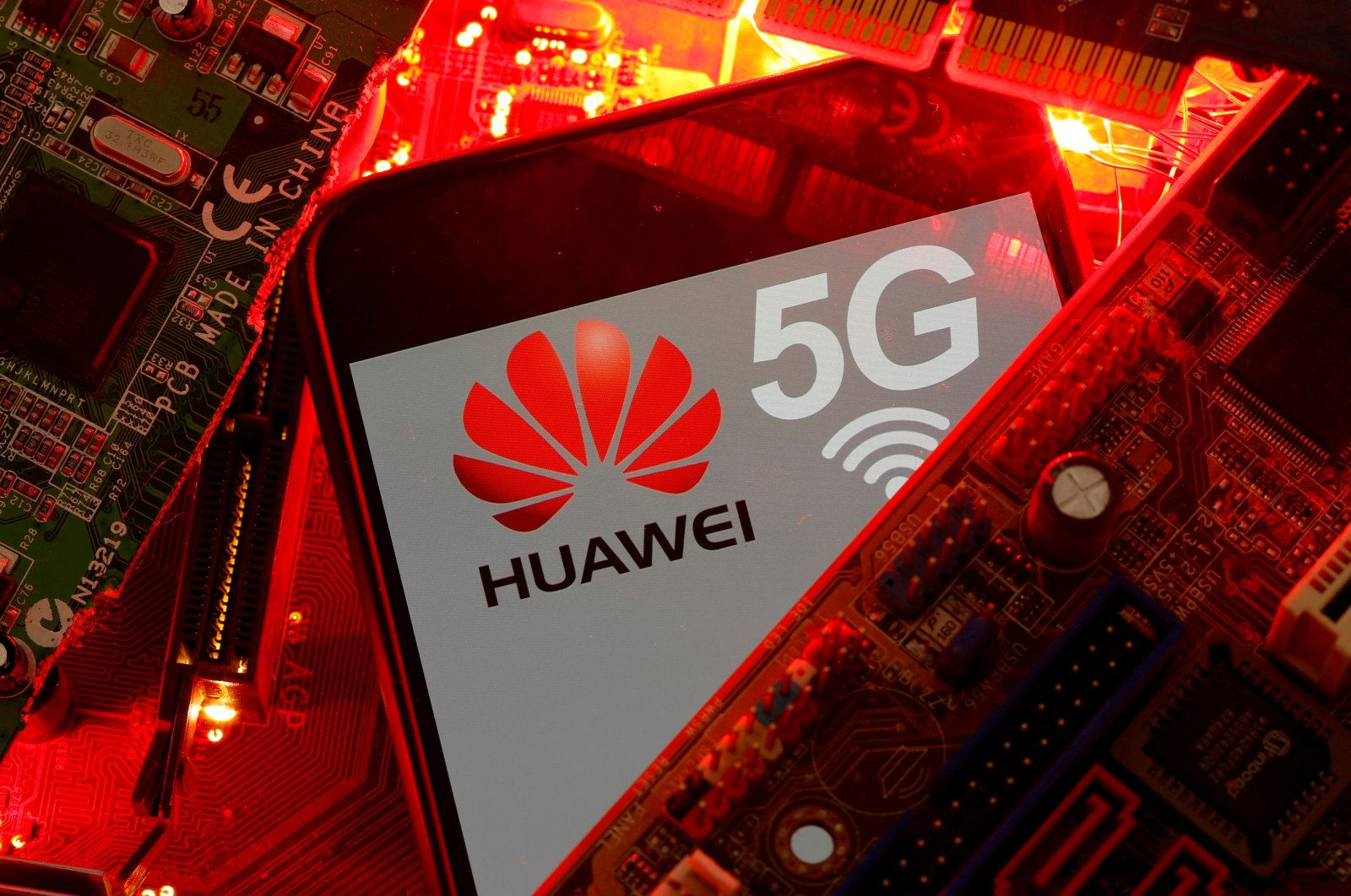 A smartphone with the Huawei and 5G network logo on a PC motherboard. (Reuters Photo)
