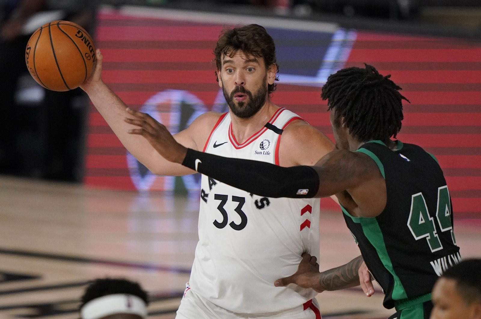 Marc Gasol (L) and Robert Williams III in action during an NBA game between the Toronto Raptors and Boston Celtics, in Lake Buena Vista, Florida, U.S, Nov. 24, 2020. (AP Photo)