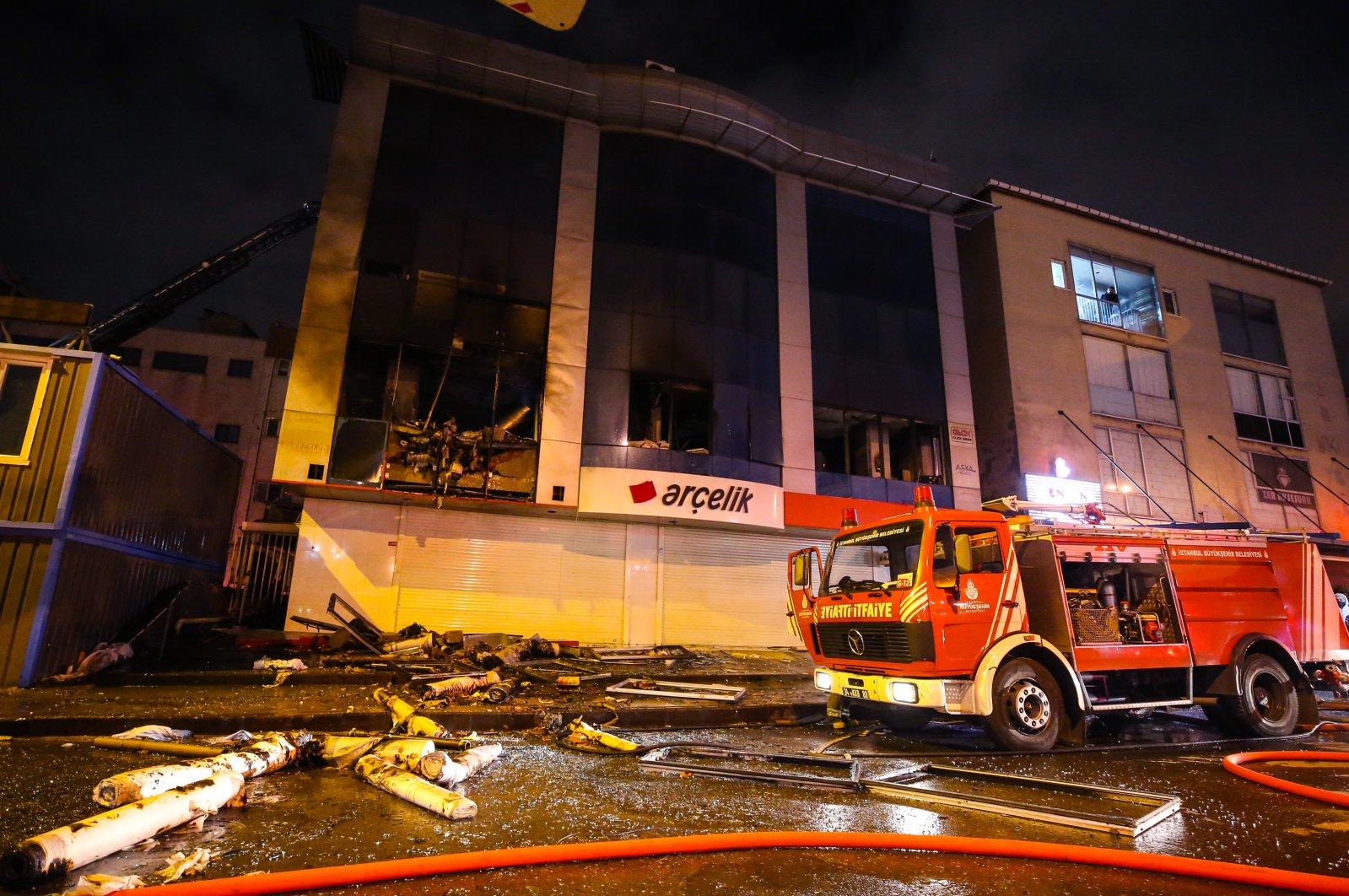 A fire truck outside a burned building in Bahçelievler district, in Istanbul, Turkey, Nov. 19, 2020. (AA Photo)