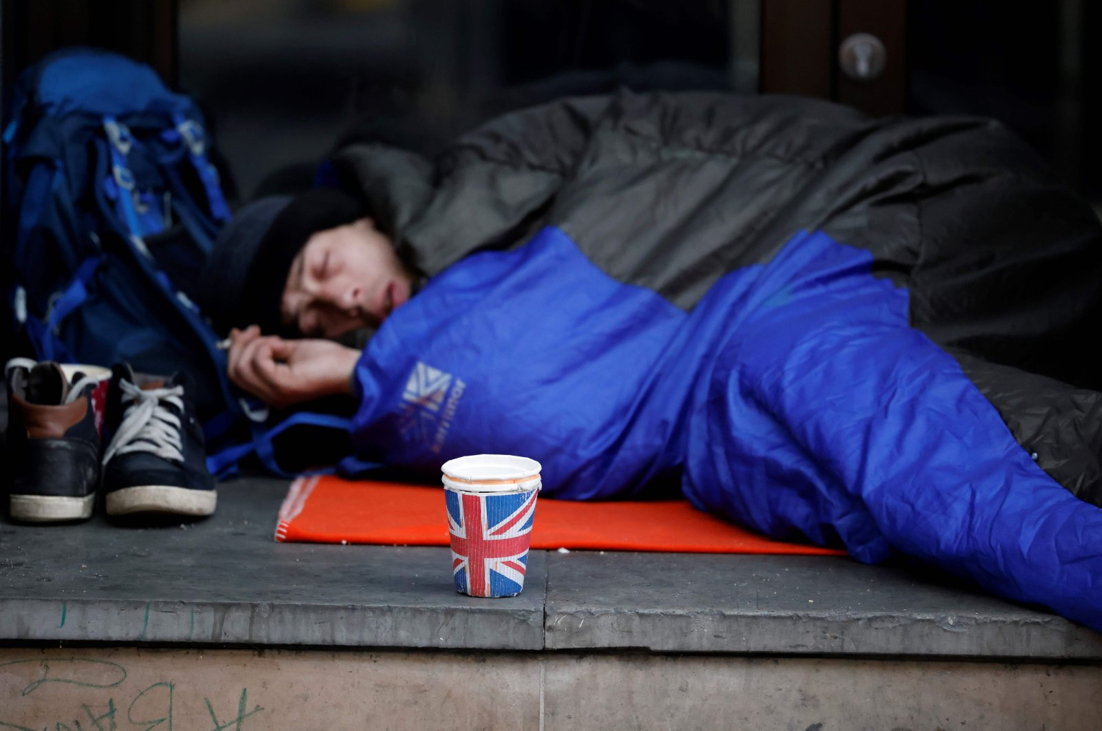 A homeless person lays in a sleeping bag on a pavement near Piccadilly Circus in central London on Nov. 25, 2020. (AFP Photo)
