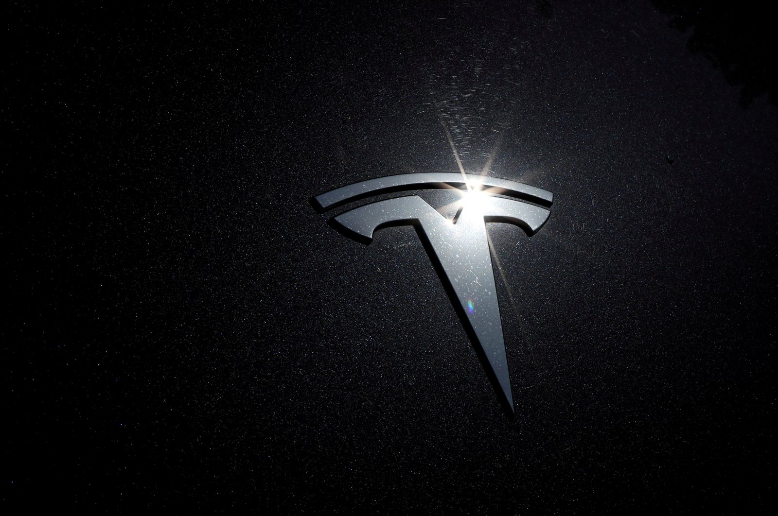 The Tesla logo is seen on a car in Los Angeles, California, U.S. on July 9, 2020. (Reuters Photo)