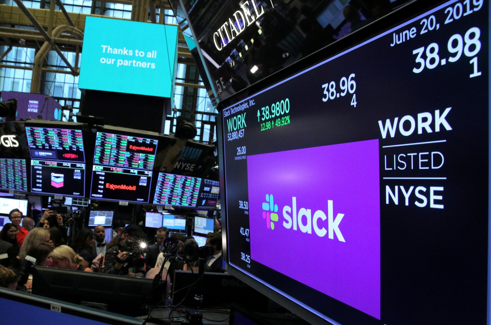 The stock price of Slack Technologies Inc. trading under the symbol (WORK) is seen on a display above the floor of the New York Stock Exchange (NYSE) during the company's direct listing in New York, U.S. on June 20, 2019. (Reuters Photo)