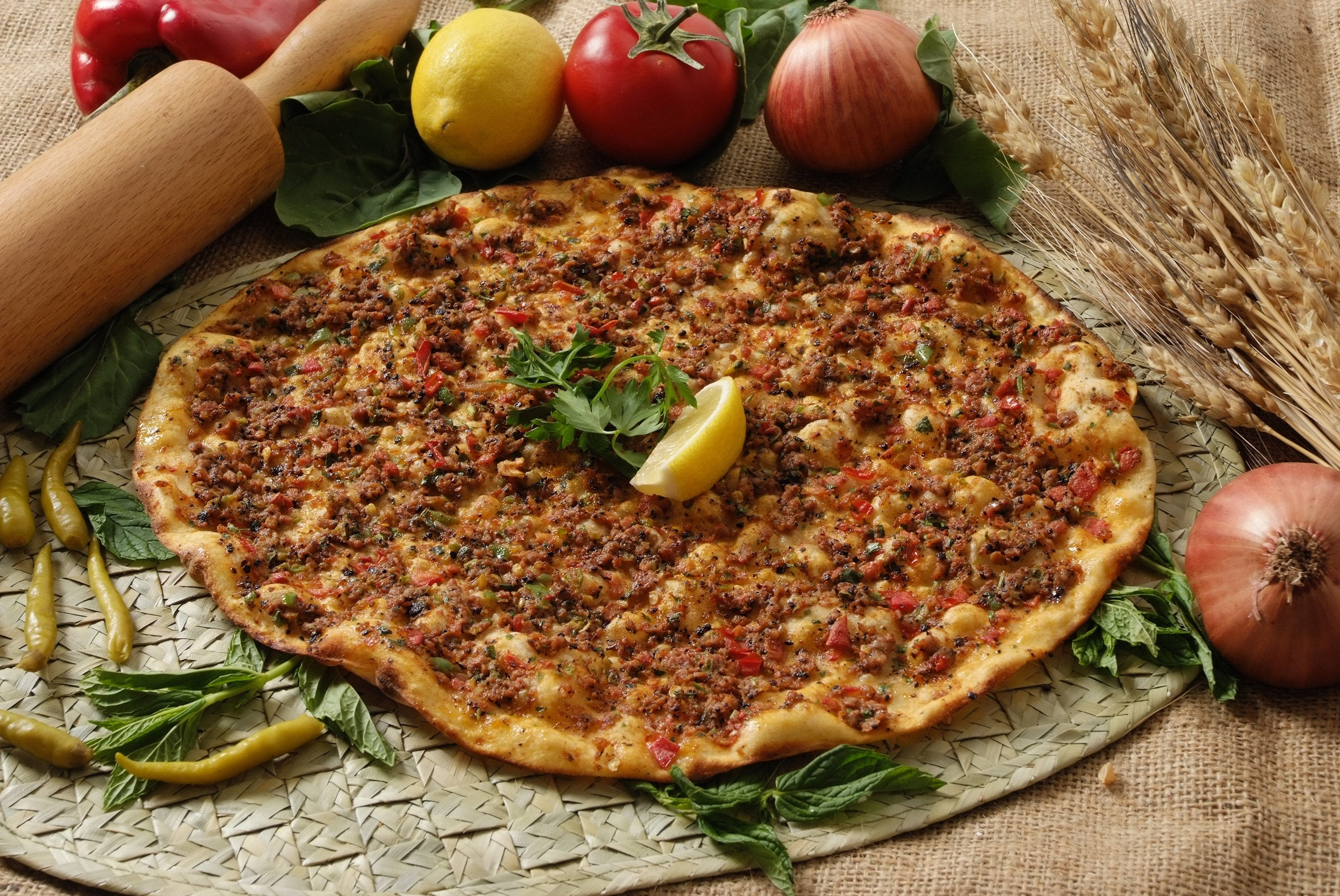 Turkish lahmacun is the lighter cousin of pide and pizza, without the cheese. (Shutterstock Photo)