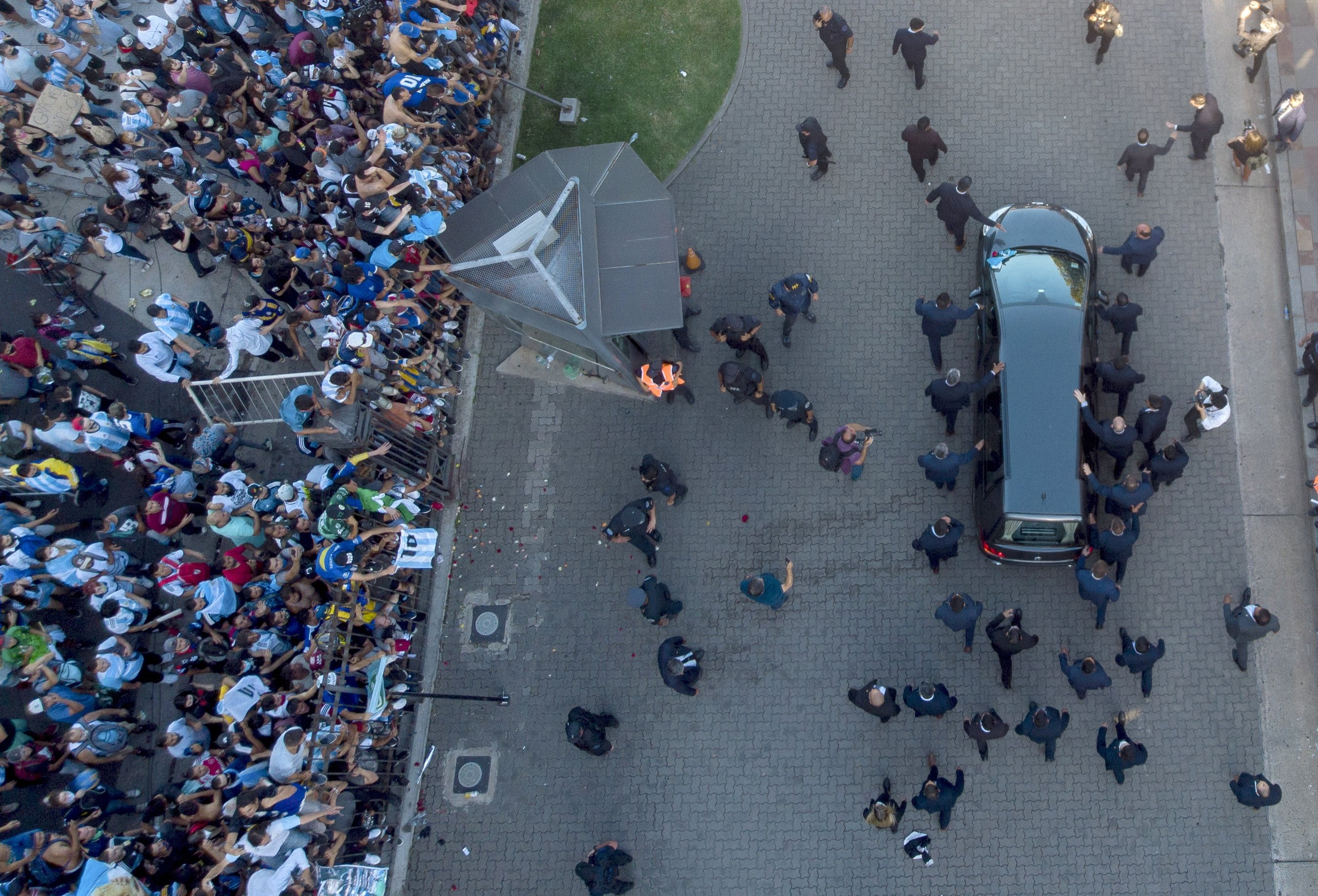 The hearse carrying the casket of Diego Maradona leaves the government house in Buenos Aires, Argentina, Nov. 26, 2020.  (AP Photo)