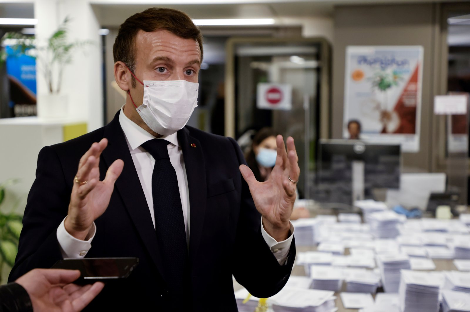 French President Emmanuel Macron speaks during a visit to the 2020 Phoneton, an annual fundraising operation organized by the Hayastan All-Armenian Fund's French affiliate (Fonds Armenien de France) for the development of Armenia and Nagorno-Karabakh, in Paris, France, Nov. 21, 2020. (REUTERS Photo)