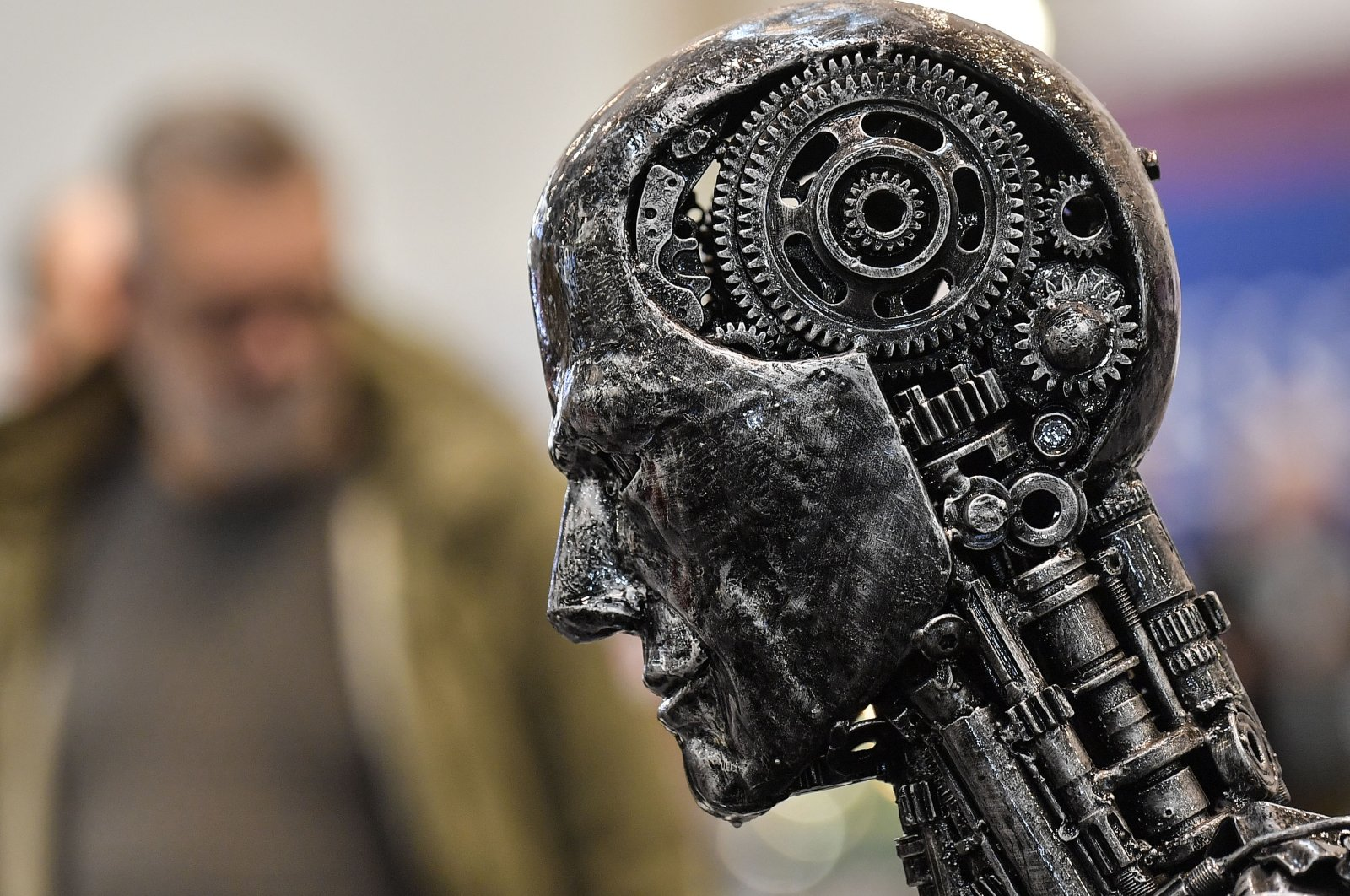 A metal head made of motor parts symbolizes artificial intelligence (AI) at a fair in Essen, Germany, Nov. 29, 2019. (AP Photo)